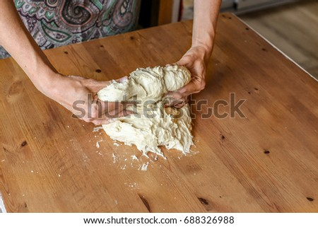 woman kneads dough for bread #688326988