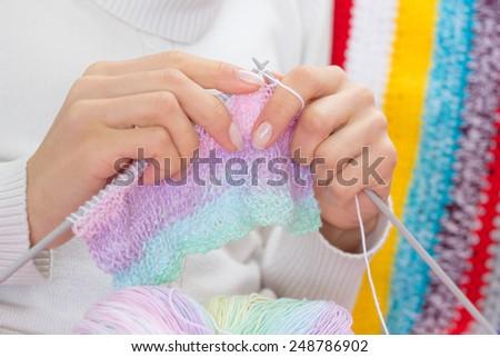Woman knitting sweater