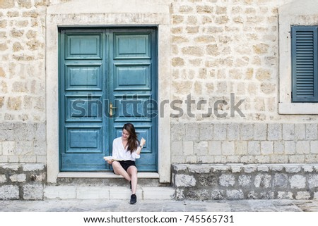 Woman laughing and reading a book