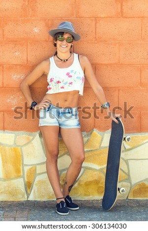 Woman laughing with Skateboard on the street