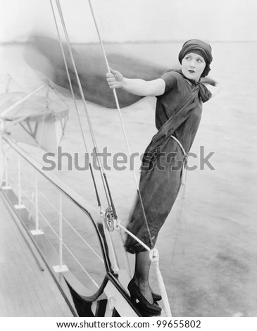 Woman leaning off boat into the wind