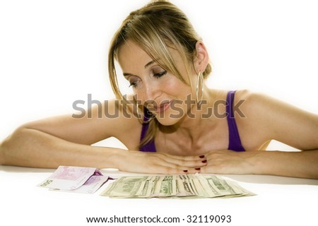 Woman leaning on a table looking at some cash