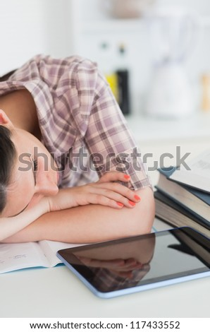 Woman leaning on the table and resting in a living room