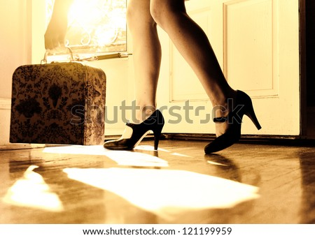 Woman leaving through the door