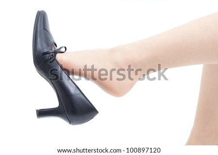 Woman leg, taking off shoes, isolated on white background - stock photo