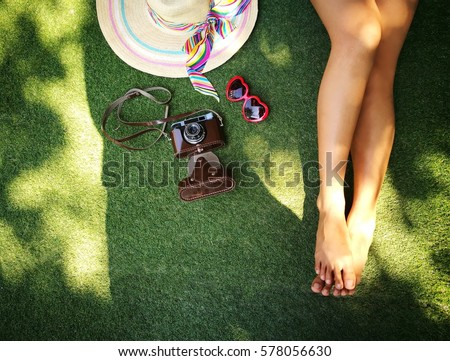 Woman leg with camera and hat with copy space ,summer concept  #578056630