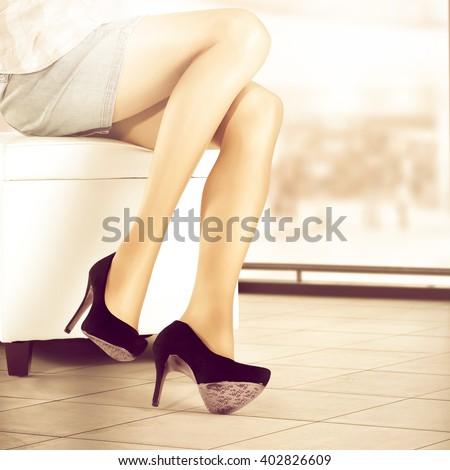 woman legs and black shoes