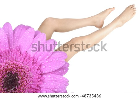 woman legs and feet and flower over white background