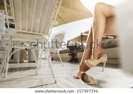 woman legs and summer time  #557397196