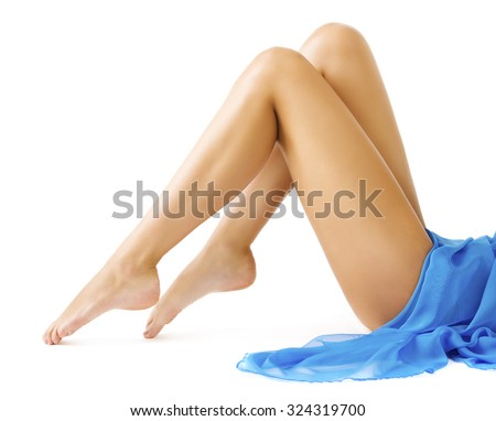 Woman Legs Body Beauty, Slim Leg Smooth Skin, Girl in Blue Dress Lying on White background