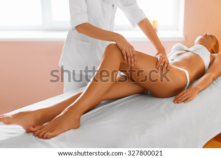 Woman legs body care beautiful woman getting leg massage treatment in spa salon skin care - Salon massage body body paris ...