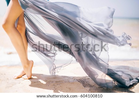 Woman Legs, Girl in Blue Waving Dress, Smooth Skin Leg Tiptoe on White