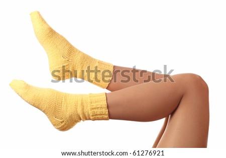 woman legs in woollen socks .