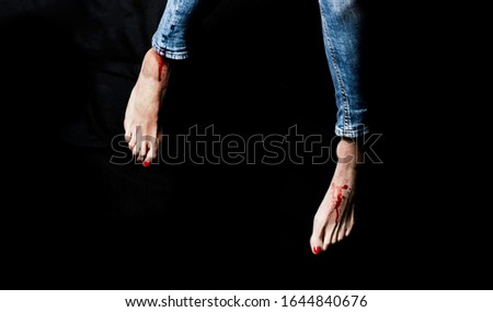 woman legs un jeans and feets with blood