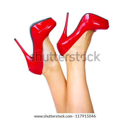 Woman legs with a red sexy shoes. Isolated on white background.