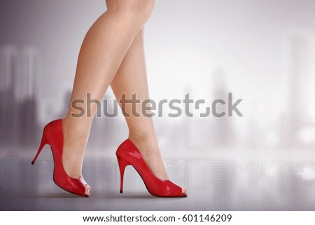 Woman legs with high heel shoes on blurred outdoor