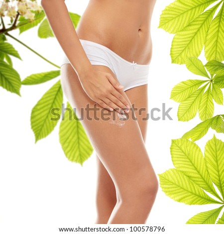 Woman legs with moisturizer horse chestnut body cream
