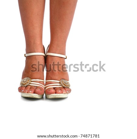 Woman legs with white high heel shoes over white
