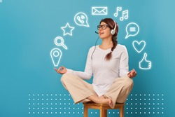 Woman levitates in lotus position with headset. Concept of balance,tech support, work from home, online business or freelance work.