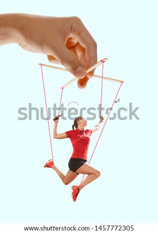 Woman like a puppet in somebodies hands on blue background. Concept of unfair manipulation, phycology of exploitation, mental technique, motivation. Puppets and their masters. Possessive relationship. #1457772305