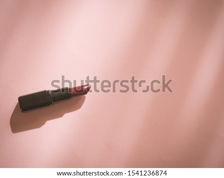 Woman lipstick on pink background with copy space background with copy space