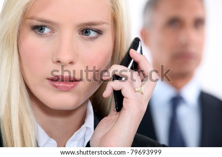 Woman listening to messages on her phone