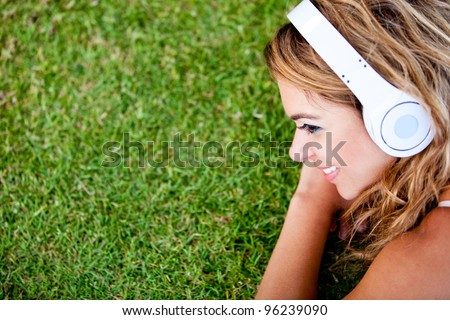 Woman listening to music and relaxing outdoors