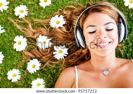 Woman listening to music with headphones outdoors