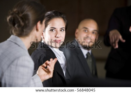 Woman listening to office colleague during presentation