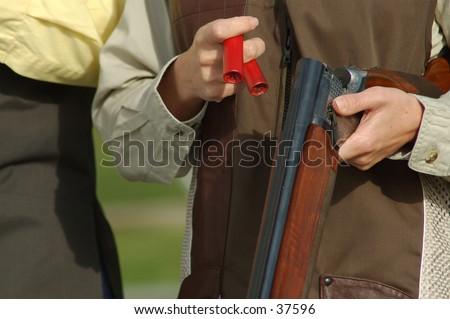 woman loading a shotgun