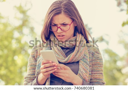 Woman looking angry at the phone