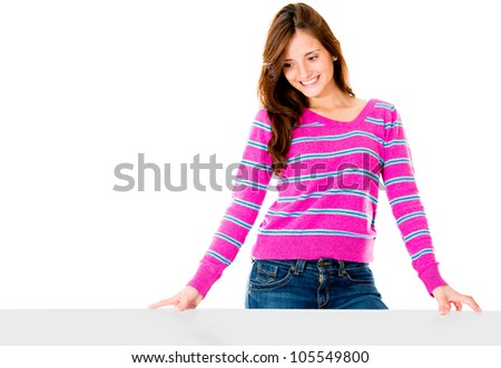 Woman looking at an imaginary object on the table and smiling