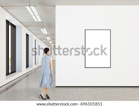 Woman looking at blank vertical poster in modern gallery. Poster isolated with clipping path. 3d illustration