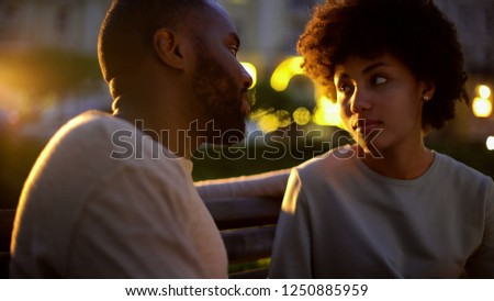 Woman looking at boyfriend with hope, outdoor date, misunderstanding, conflict Stock photo ©