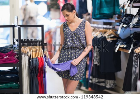 Woman looking at clothes in boutique