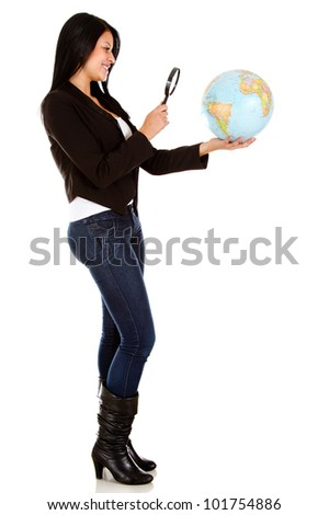 Woman looking at the globe with a magnifying glass - isolated
