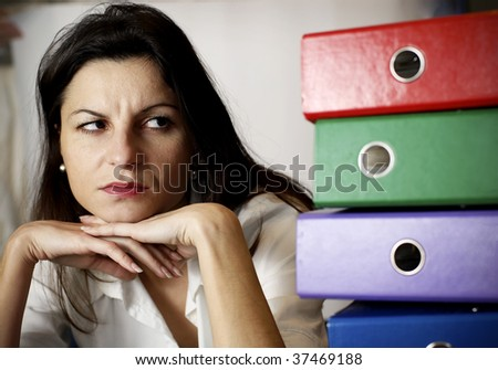 woman looking at the office folders
