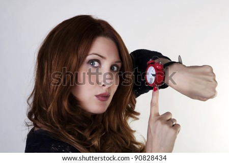 woman looking at watch who running late