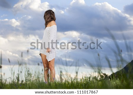 woman looking back over her shoulder