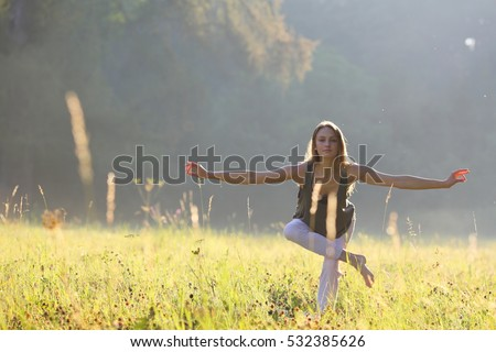 Woman looking for a balance in park #532385626