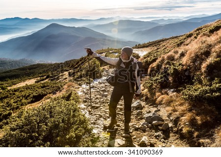 woman looking for right way on track in mountains - Shutterstock ID 341090369