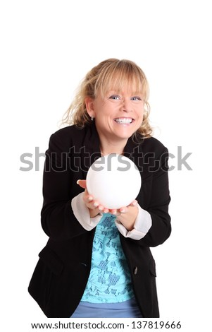 Woman looking in to the future holding a glass ball. White background.