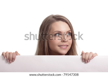 Woman looking over blank card in the studio