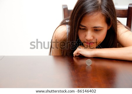 woman looking rolling coin