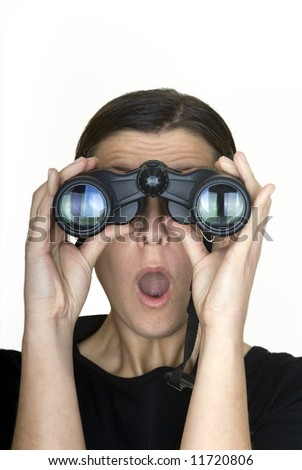 woman looking through binoculars with surprised expression