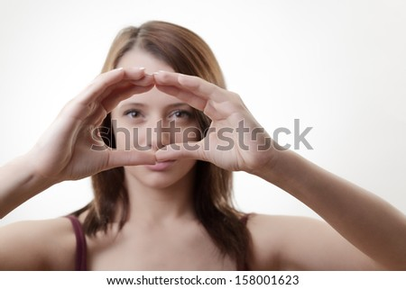 woman looking through hands in a large circle