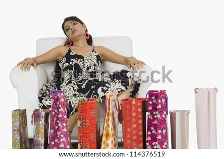 Woman looking tired with shopping