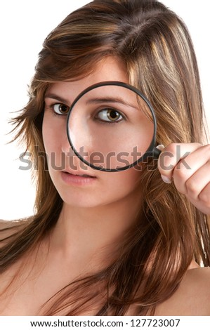Woman looking trough a magnifying glass, isolated in a white background