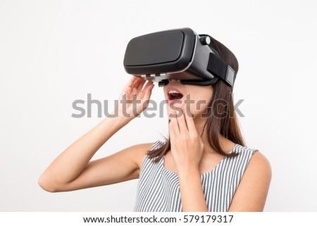 Woman looking with VR device and feeling excite #579179317