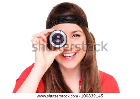 woman looks in the camera lens. shows the internal mechanism. positively smiling. close-up